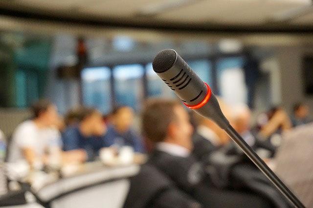 microphone before persuasive public speaking engagement
